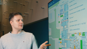 Expert introducing the installation map of the IoT network at the University of Oulu